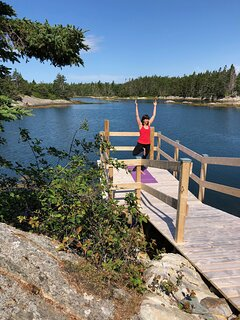 Morning yoga on our dock and cove.