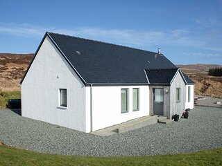 Cuillin Cottage, spacious family home overlooking Portree and the Cuillins.