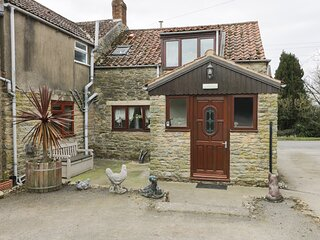 BOUNDCLIFFE FARM, pet friendly, character holiday cottage, with a garden in