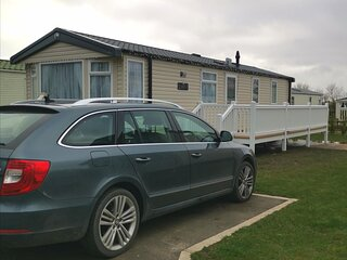 Beautiful 6 berth caravan for hire with decking at Skipsea Sands ref 41035B
