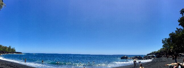 Swim at black sands Kahena Beach on the South East side