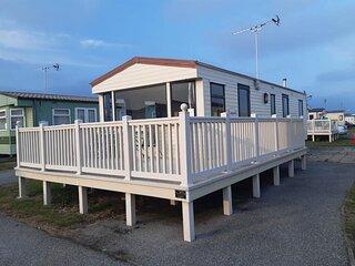 6 berth caravan with decking at Seawick Holiday Park in Essex ref 27430S