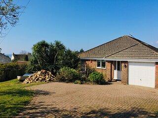 Spacious coastal bungalow, ample outdoor garden/patio with short walk to beach