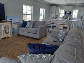 Everything is new! Beautiful, Bright & Spacious end unit, steps to the Gulf & Pr