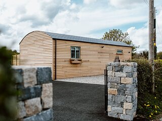 Two bedroom riverside log cabin with panoramic views of the Mourne Mountains.