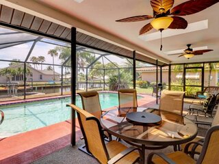 Desirable SE Cape Coral Pool Home! Newly Remodeled, Beautiful Canal Front View!