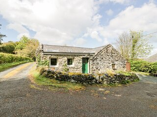 TY CERRIG, pet friendly, character holiday cottage with a garden in Llanbedr