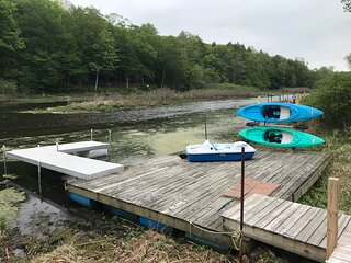 View of kayaks, pedal boat, docks, and into channel. Please note, low water levels in 2021.