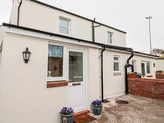 ST CUTHBERT'S COTTAGE, welcoming cottage, with three bedrooms, decked area