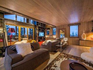 Chalet d'exception aux nombreuses baies vitrees avec vue panoramique