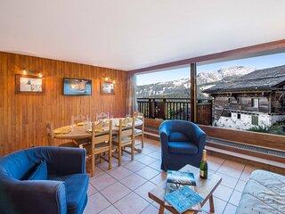 Pralong 400 : Magnifique vue sur les montagnes, skis aux pieds.