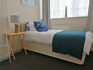 Ground Floor Two Bedroom with Parking and Short Walk to Beach