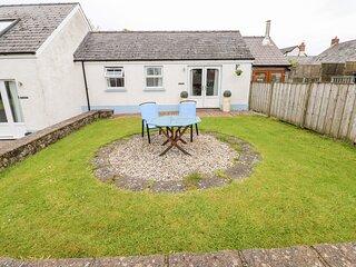 TY GLAS, semi-detached cottage, all ground floor, en-suite, garden, near
