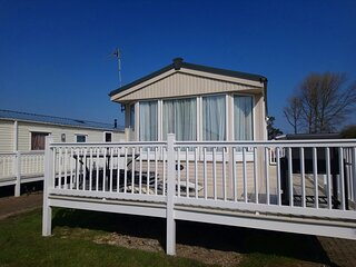 Great 6 berth caravan for hire with decking at Naze Marine in Essex ref 17008WC