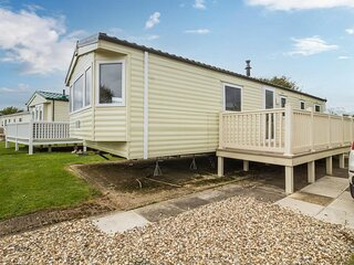 Lovely caravan for hire with decking at Skipsea Sands Holiday Park ref 41161WF