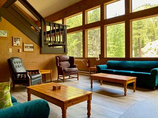 Our spacious, creekside, 70's chalet is so hygge