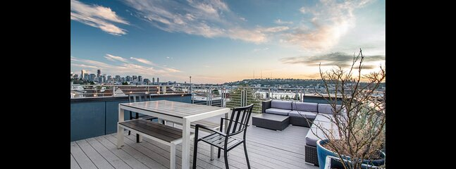 Enjoy sweeping views of Seattle, Lake Union, and the mountains from your private rooftop!