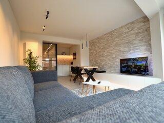 Lichtrijk en luxueus appartement op 100m van zee