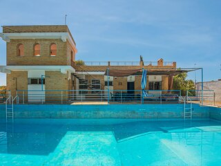 Nice home in Sevilla with Outdoor swimming pool and 4 Bedrooms (EAC569)