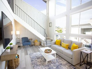 Newly remodeled bayfront home with floor to ceiling windows