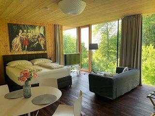Designer-Apartment im Architekten-Haus aus Holz