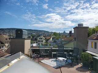 ROOF top suite, charming, well furnished, huge TV