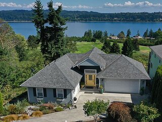 4 bedrooms,3.5 baths + gym & game room overlooking sound & golf course(293)