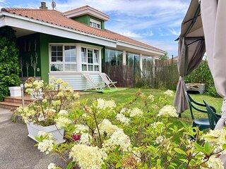 Espaciosa casa con jardin cercana a la playa