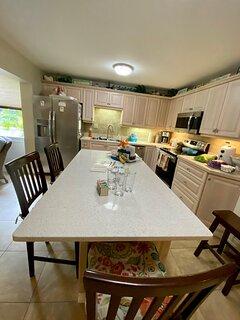 New gourmet kitchen with large quartz Island