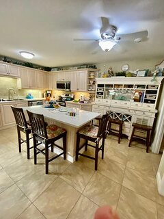 Gourmet kitchen with many supplied staples
