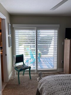Master bedroom with sun deck view