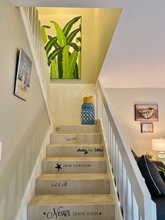 Decorated stairs to 2nd floor and bedrooms