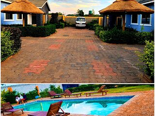 Authentic African Retreat with Pool & Chalets