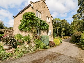 UNDERBANK HALL COTTAGE, pet friendly, country holiday cottage, with a garden in