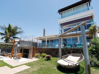 Casa cinematográfica com piscina privativa, beira mar