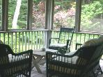 Screened sitting porch.