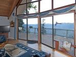 The living room has a panoramic view of the water.