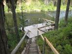 Steps leading from back deck to landing on Payette River