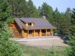 Quint essential Montana log cabin, in a grove of pine trees with great mountain views