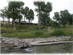 A view of the home from across the creek