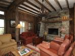 Cozy living room situated around a gorgeous rock fireplace