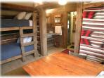 The interior of the bunk house with 4 bunk beds