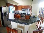 Full Kitchen with granite counters and breakfast bar