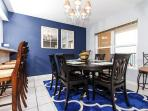 Flowing into the dining area, the tiled flooring highlights the