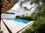 Pool area with palm thatched gazebo