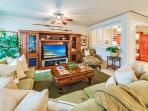 Island Oasis M111 - Fresh and Sunny Great Room at M111 with a new area rug, new HDTV, decor pillows, and other...