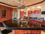 Exceptionally Well-Equipped Kitchen with Panoramic Ocean View, Espresso Machine and Quality Cooking and Dining Supplies