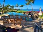 A View of the Beach Front Adult Infinity-Edge Heated Swimming Pool set Directly on Wailea Beach at Dawn - Enjoy the...