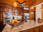 Granite kitchen with stainless steel appliances