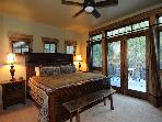 Master bedroom with doors to the back deck